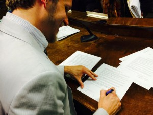 Clarkston Mayor Ted Terry signs Welcoming resolution